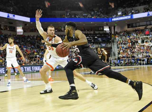 Gardner-Webb's DJ Laster (25) drives down the baseline against Virginia's Jack Salt (33) during a first-round game in the NCAA mens college basketball tournament in Columbia, S.C. Friday, March 22, 2019. (AP Photo/Richard Shiro)