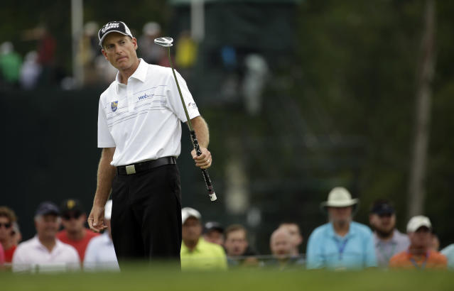 Jim Furyk watches his putt on the first hole during the third round of the PGA Championship golf tournament at Valhalla Golf Club on Saturday, Aug. 9, 2014, in Louisville, Ky. (AP Photo/Jeff Roberson)