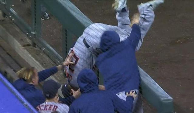 Astros third baseman J.D. Davis tumbles into the dugout after catching Nolan Arenado's pop foul. (MLB.TV)