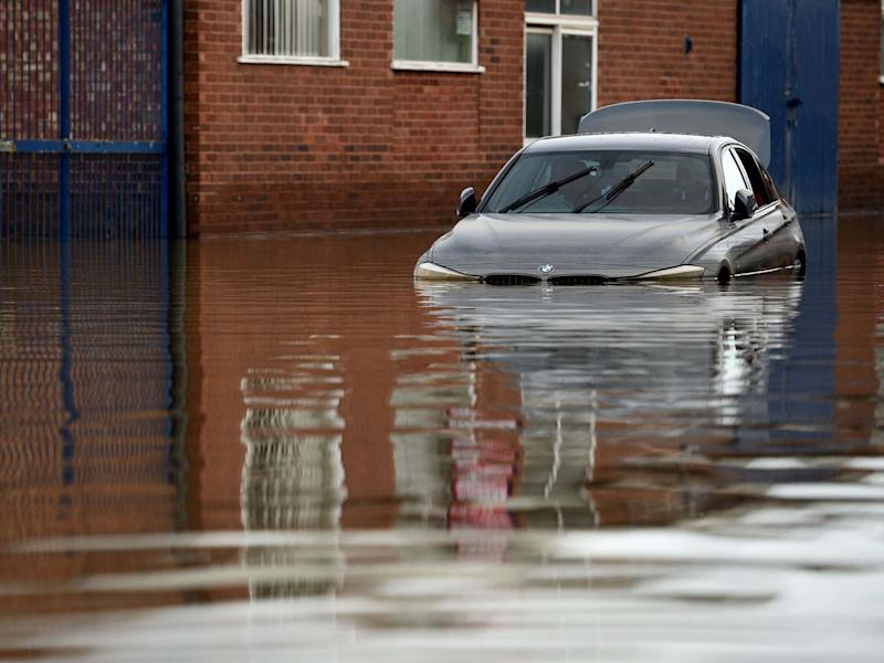 A car is partially submerged in flood waters in Shrewsbury, Shropshire, 26 February 2020: Oli Scarff/AFP via Getty Images