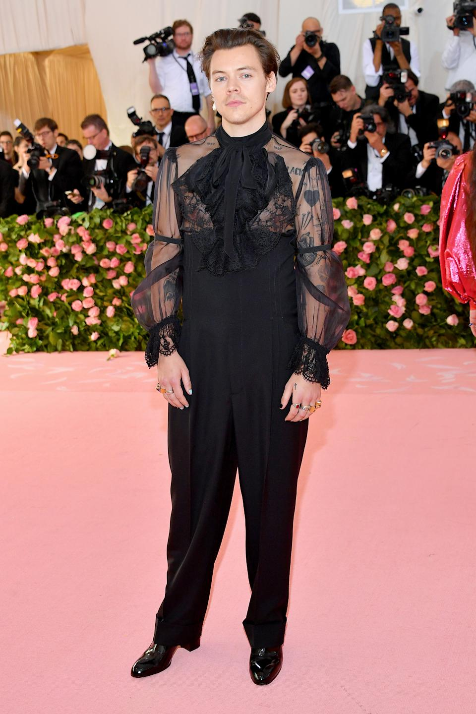 Harry Styles took the night's theme 'Camp: Notes on Fashion' very seriously for his first ever appearance at the event, and arrived in a sheer black top with lace detailing, which he matched with high-waisted black and heels. Photo: Getty Images