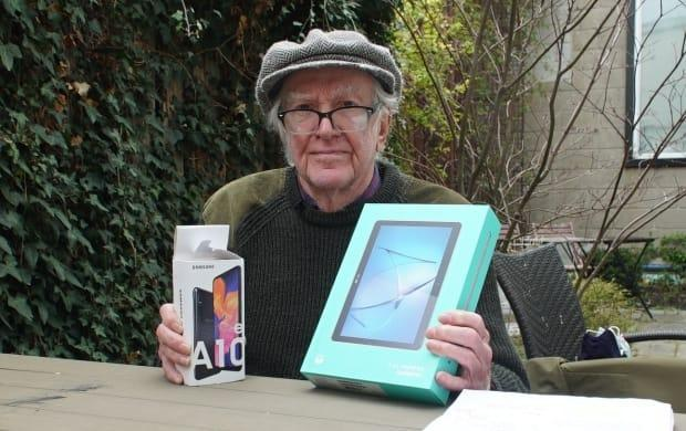 Ross Miller, who has Alzheimer's, went to The Source in Toronto to buy a TV. Instead a salesperson sold him a Bell Fibe TV package, a landline, a tablet and two-year contracts for high-speed internet and a cell phone. (Keith Burgess/CBC - image credit)
