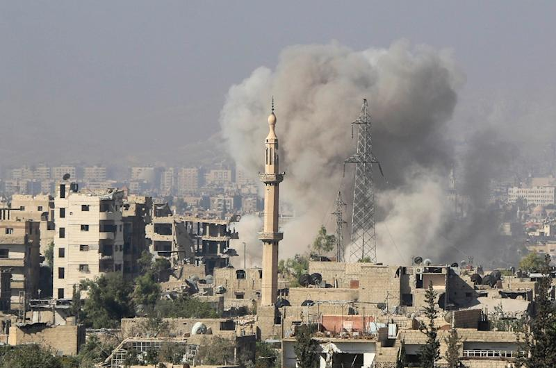 Smoke billows following reported Syrian regime bombings on rebel positions in Jobar, in eastern Damascus, on October 15, 2015