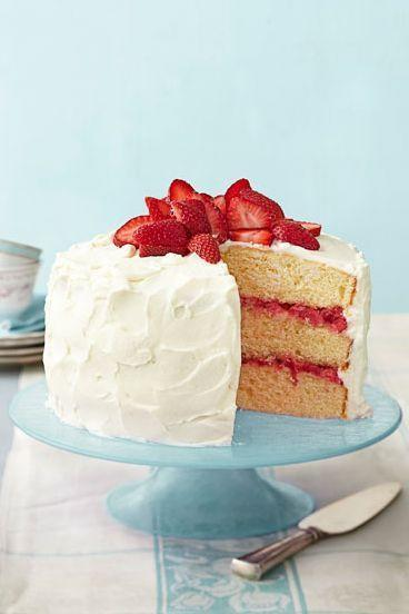 """<p>This cake looks like a traditional birthday cake on the outside but keeps things interesting with a strawberry-rhubarb filling.</p><p><em><strong><a href=""""https://www.womansday.com/food-recipes/food-drinks/recipes/a39888/strawberry-rhubarb-layer-cake-recipe-ghk0414/"""" rel=""""nofollow noopener"""" target=""""_blank"""" data-ylk=""""slk:Get the Strawberry Rhubarb Cake recipe."""" class=""""link rapid-noclick-resp"""">Get the Strawberry Rhubarb Cake recipe.</a></strong></em></p>"""