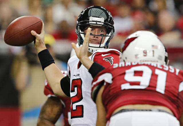 Atlanta Falcons quarterback Matt Ryan (2) throws under pressure from Arizona Cardinals outside linebacker Matt Shaughnessy during the first half of an NFL football game Sunday, Oct. 27, 2013, in Glendale, Ariz. (AP Photo/Rick Scuteri)