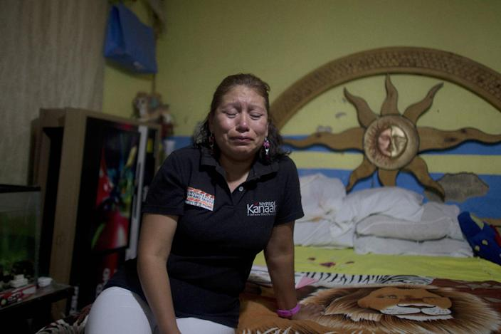Amelia Reyes-Jimenez cries as she talks about her children to the Associated Press at her sister's home in Zapopan, Mexico, Friday, Aug. 17, 2012. Reyes-Jimenez, carried her blind and partly paralyzed baby boy, Cesar, across the Mexican border in 1995 seeking better medical care. She settled in Phoenix illegally and had three more children, all American citizens. In 2008 she was arrested after her disabled teen son was found home alone. Locked up in detention, clueless as to her rights or what was happening to her children, she pleaded guilty to child endangerment charges, and then spent two years trying to fight for her right to stay with her children. She lost and was deported back to Mexico without her children in 2010. (AP Photo/Dario Lopez-Mills)