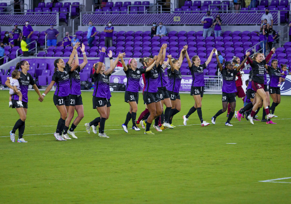 Orlando Pride celebrate with the fans after the NWSL soccer match between the Orlando Pride and theWashington Spirit on May 16, 2021 at Explorer Stadium in Orlando, FL. (Photo by Andrew Bershaw/Icon Sportswire via Getty Images)