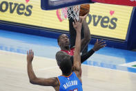 Miami Heat guard Kendrick Nunn, rear, shoots in front of Oklahoma City Thunder guard Theo Maledon, front in the second half of an NBA basketball game Monday, Feb. 22, 2021, in Oklahoma City. (AP Photo/Sue Ogrocki)