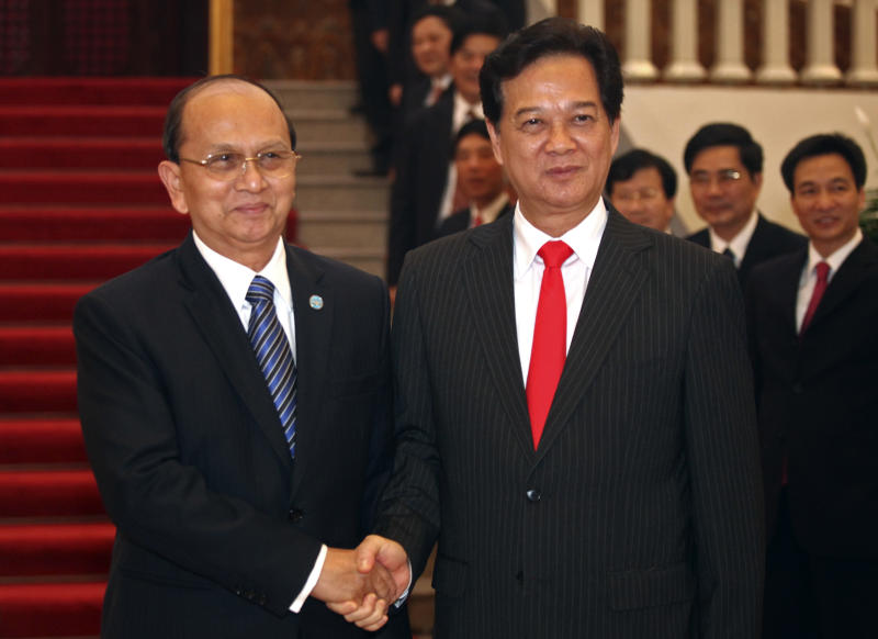 Myanmar President Thein Sein, left, and Vietnamese Prime Minister Nguyen Tan Dung shake hands at the Government House during Tuesday, March 20, 2012 in Hanoi, Vietnam. Myanmar President Thein Sein has arrived in Vietnam for his two day official visit on Tuesday. (AP Photo/Na Son Nguyen)