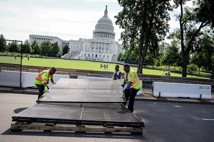 Crowds return to the US Capitol grounds in Washington DC on 10 July after crews removed the final barricades installed after the riot on 6 January. (REUTERS)