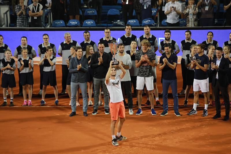 Dominic Thiem (Front) of Austria celebrates by raising the trophy after winning the final match against Filip Krajinovic of Serbia at the Adria Tour charity exhibition hosted by Novak Djokovic on June 14, 2020, in Belgrade, Serbia.