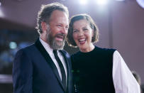 FILE - In this Sept, 3, 2021 file photo Peter Sarsgaard, left, and Maggie Gyllenhaal pose for photographers upon arrival at the premiere of the film 'The Lost Daughter' during the 78th edition of the Venice Film Festival in Venice, Italy. (AP Photo/Domenico Stinellis, File)