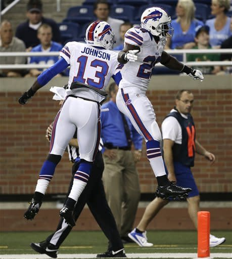 Buffalo Bills wide receiver Steve Johnson (13) celebrates his 4-yard touchdown reception with running back C.J. Spiller (28) against the Detroit Lions in the first quarter of their NFL preseason football game in Detroit, Thursday, Aug. 30, 2012. (AP Photo/Paul Sancya)