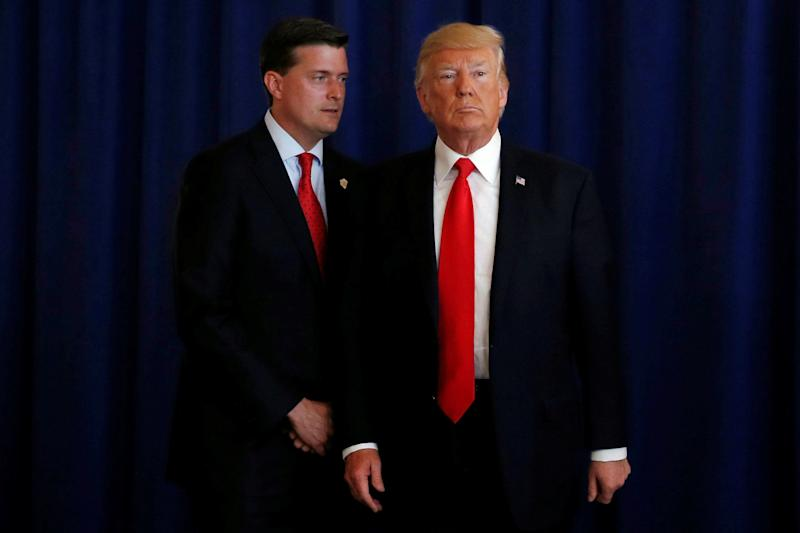 Then-White House staff secretary Rob Porter is seen with President Donald Trump in August.