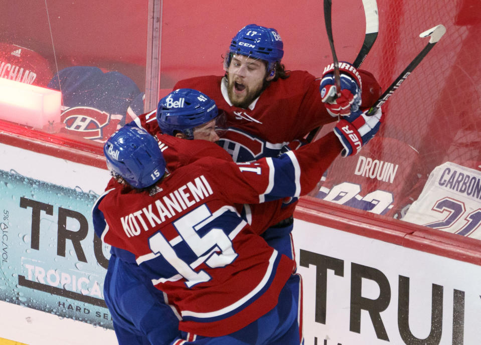 Montreal Canadiens' Josh Anderson celebrates with Paul Byron and Jesperi Kotkaniemi after scoring in overtime against the Vegas Golden Knights in Game 3 of an NHL hockey semifinal series, Friday, June 18, 2021, in Montreal. (Paul Chiasson/The Canadian Press via AP)