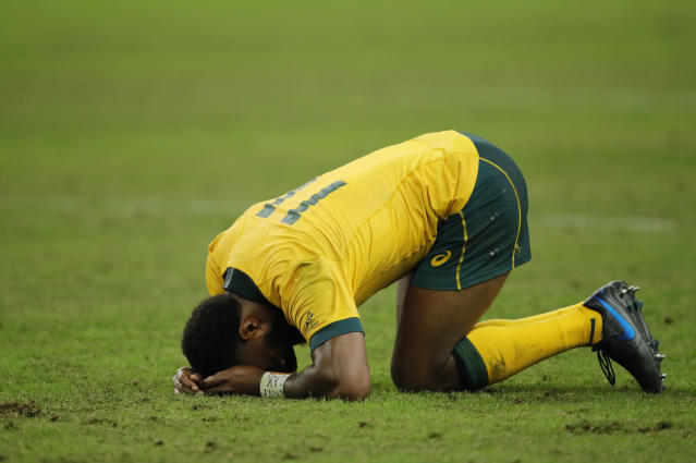 Australia's Marika Koroibete reacts after their 40-16 loss to England in the Rugby World Cup quarterfinal match at Oita Stadium in Oita, Japan, Saturday, Oct. 19, 2019. (AP Photo/Christophe Ena)