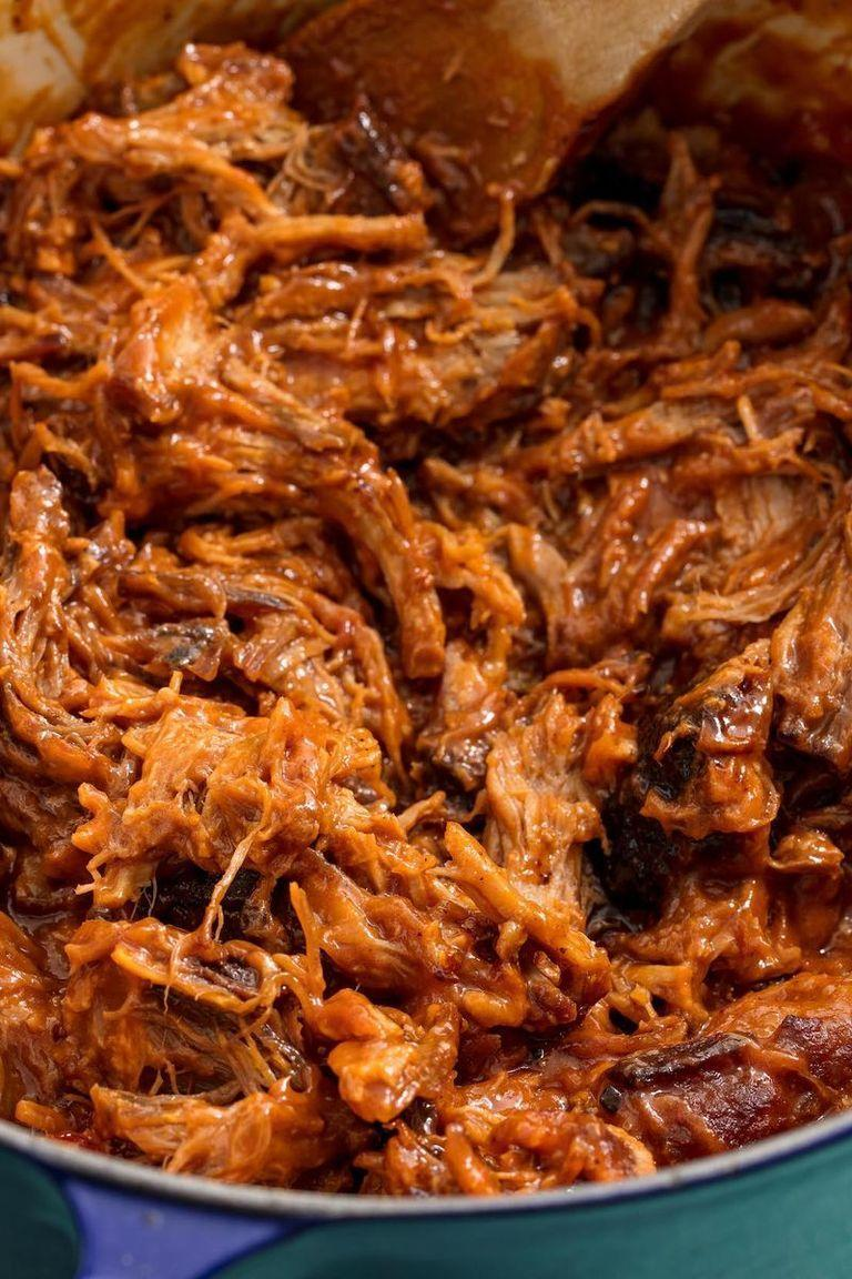 """<p>The secret to really good pulled <a href=""""http://www.delish.com/uk/pork-recipes/"""" rel=""""nofollow noopener"""" target=""""_blank"""" data-ylk=""""slk:pork"""" class=""""link rapid-noclick-resp"""">pork</a> is cooking it low and slow. I know, I know—it sounds somewhat tortuous if you're craving BBQ, like right now. But trust us, the wait is worth it in the end. Lucky for you, a slow cooker makes the drawn out process a breeze.</p><p>Get the <a href=""""https://www.delish.com/uk/cooking/recipes/a29185240/slow-cooker-pulled-pork-recipe/"""" rel=""""nofollow noopener"""" target=""""_blank"""" data-ylk=""""slk:Slow Cooker Pulled Pork"""" class=""""link rapid-noclick-resp"""">Slow Cooker Pulled Pork</a> recipe.</p>"""