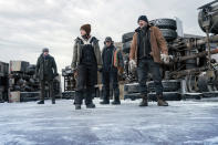 """This image released by Netflix shows Benjamin Walker, Amber Midthunder, Marcus Thomas and Liam Neeson in a scene from """"The Ice Road."""" (Allen Fraser/Netflix via AP)"""