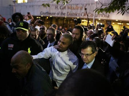 Rapper Chris Brown (C) departs the District of Colombia courthouse in Washington October 28, 2013. REUTERS/Gary Cameron