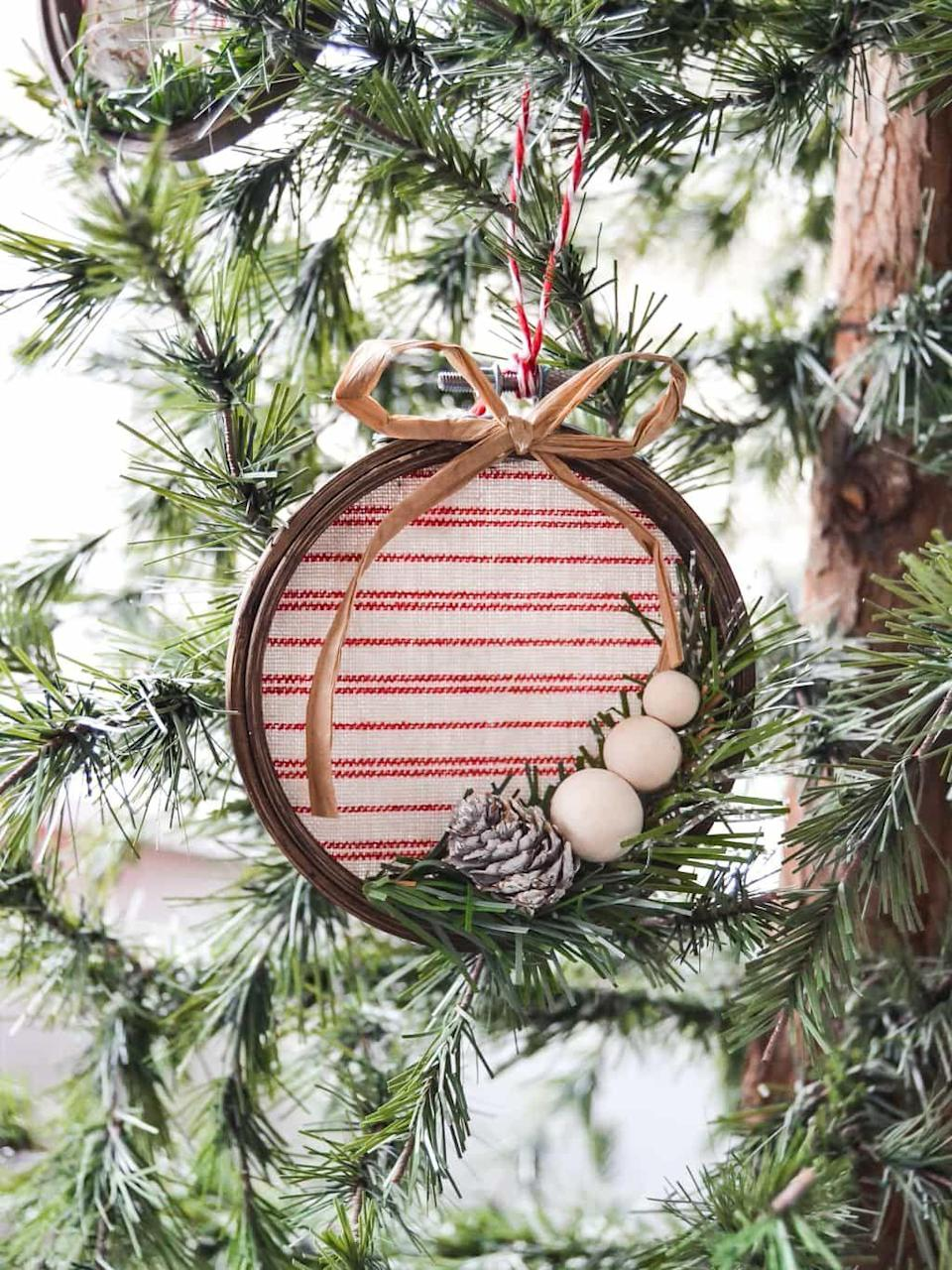 """<p>These embroidery hoop Christmas ornaments will look perfect on your tree, but they're so beautiful that we recommend making a few extra and hanging 'em on doorknobs and windows.</p><p><strong>Get the tutorial at <a href=""""https://mycreativedays.porch.com/diy-embroidery-hoop-christmas-ornament/"""" rel=""""nofollow noopener"""" target=""""_blank"""" data-ylk=""""slk:My Creative Days"""" class=""""link rapid-noclick-resp"""">My Creative Days</a>.</strong></p><p><a class=""""link rapid-noclick-resp"""" href=""""https://www.amazon.com/Wooden-Embroidery-Wholesale-Pieces-Darice/dp/B01M3MPL8J/?tag=syn-yahoo-20&ascsubtag=%5Bartid%7C10050.g.1070%5Bsrc%7Cyahoo-us"""" rel=""""nofollow noopener"""" target=""""_blank"""" data-ylk=""""slk:SHOP EMBROIDERY HOOPS"""">SHOP EMBROIDERY HOOPS</a></p>"""