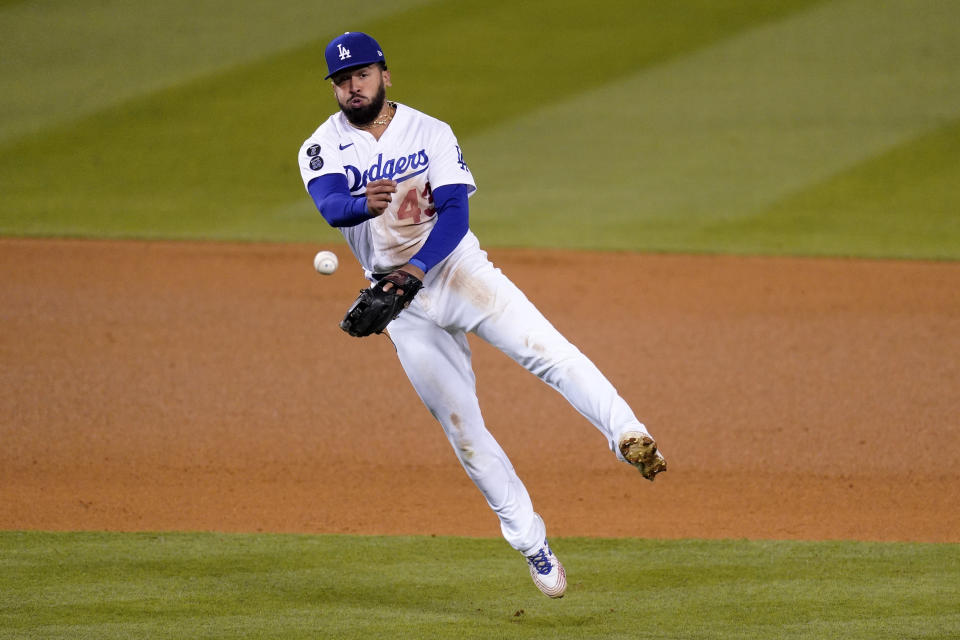 Los Angeles Dodgers third baseman Edwin Rios throws out Cincinnati Reds' Tucker Barnhart at first during the ninth inning of a baseball game Monday, April 26, 2021, in Los Angeles. (AP Photo/Mark J. Terrill)