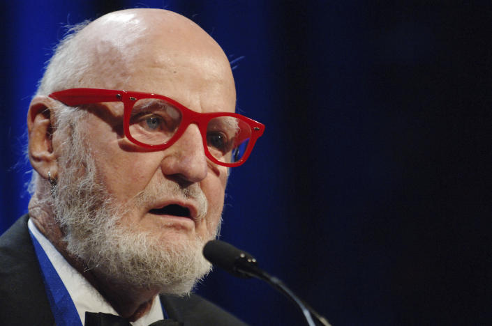 FILE - Author Lawrence Ferlinghetti recites a poem after he was awarded the Literarian Award for Outstanding Service to the American Literary Community at the National Book Awards in New York, on Nov. 16, 2005. Ferlinghetti, a poet, publisher and bookseller has died in San Francisco at age 101. His son says Ferlinghetti died at home on Monday, Feb. 22, 2021. Ferlinghetti helped launch and perpetuate the Beat movement. He was known for his City Lights bookstore in San Francisco, an essential meeting place for the Beats and other bohemians in the 1950s and beyond. (AP Photo/Henny Ray Abrams, File)