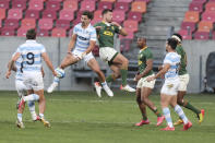 Handre Pollard of South Africa and Ignacio Mendy of Argentina, top left, challenge for a high ball during the second Rugby Championship match between Argentina and South Africa at the Nelson Mandela Bay Stadium, Gqebeha, South Africa, Saturday, Aug. 21, 2021. (AP Photo/Halden Krog)
