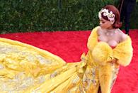 """<p>Most of the time, exhibits pay tribute to talented designers past. The theme of the gala informs how people dress. No one paid better tribute to an honored designer than <a class=""""link rapid-noclick-resp"""" href=""""https://www.popsugar.com/Rihanna"""" rel=""""nofollow noopener"""" target=""""_blank"""" data-ylk=""""slk:Rihanna"""">Rihanna</a>, when she wore a luxurious robe by Chinese couturier Guo Pei for the 2015 theme, China: Through the Looking Glass. <a href=""""https://www.popsugar.com/fashion/Met-Gala-Theme-2018-43844271"""" class=""""link rapid-noclick-resp"""" rel=""""nofollow noopener"""" target=""""_blank"""" data-ylk=""""slk:The fashion and religion theme in 2018"""">The fashion and religion theme in 2018</a> was chosen because so many designers, like John Galliano and Riccardo Tisci, reference religion in their clothing. This year's theme is yet to be announced.</p>"""