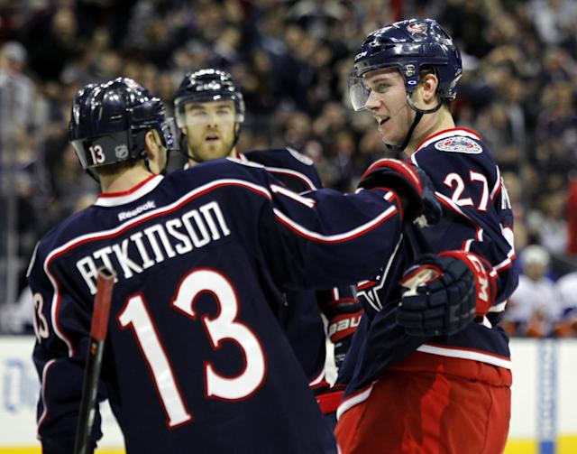 Columbus Blue Jackets' Ryan Murray, right, is congratulated by teammate Cam Atkinson after Murray scored a goal against the New York Islanders in the second period of an NHL hockey game in Columbus, Ohio, Sunday, April 6, 2014. The Blue Jackets won 4-0. (AP Photo/Paul Vernon)