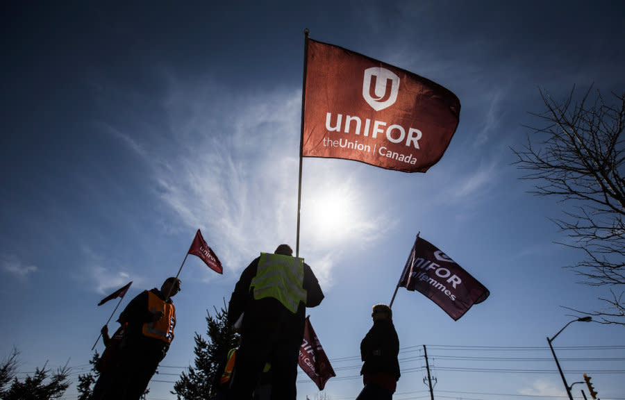Representatives from Unifor stand outside the Toyota plant in Cambridge, Ont. on March 31, 2014. The union also represents some Air Canada workers.