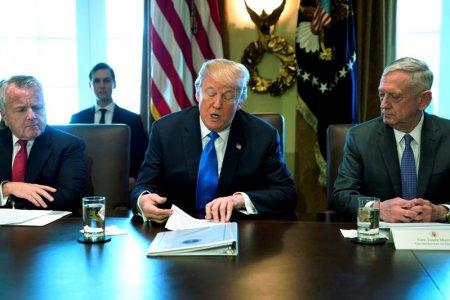 FILE PHOTO: U.S. President Donald Trump, flanked by Deputy Secretary of State John Sullivan (L) and Defense SecretaryJames Mattis (R), speaks to reporters before he holds a cabinet meeting at the White House in Washington, U.S. December 6, 2017. REUTERS/Jonathan Ernst/File Photo