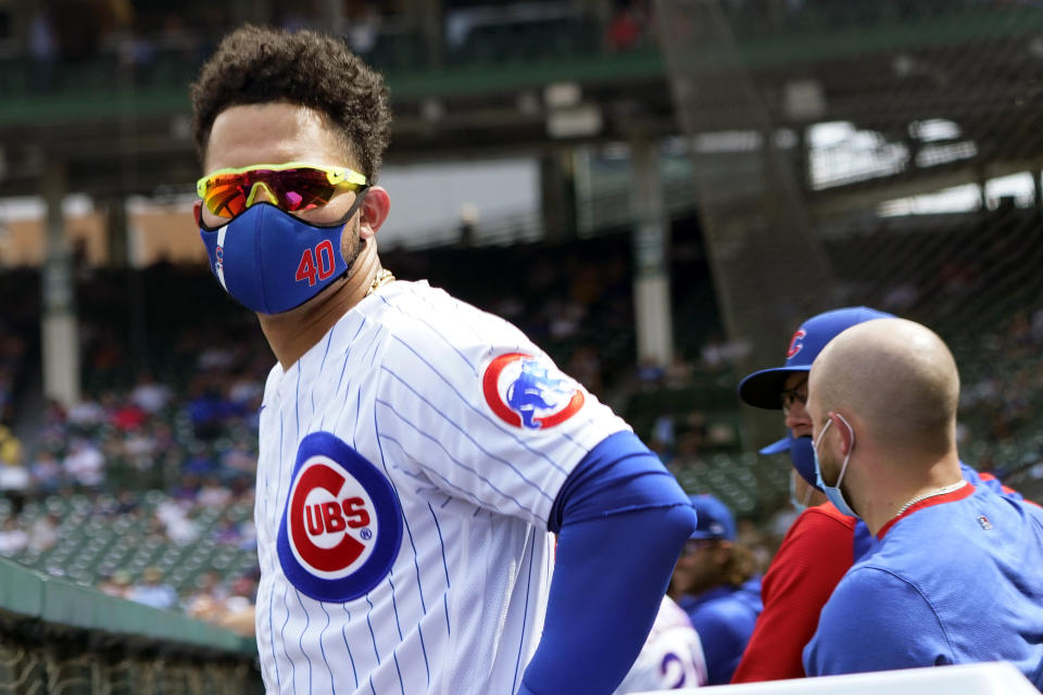 Seen through COVID-19 protective plexiglass, Chicago Cubs' Willson Contreras wears his protective mask during the fifth inning of a baseball game against the Washington Nationals Thursday, May 20, 2021, in Chicago. (AP Photo/Charles Rex Arbogast)