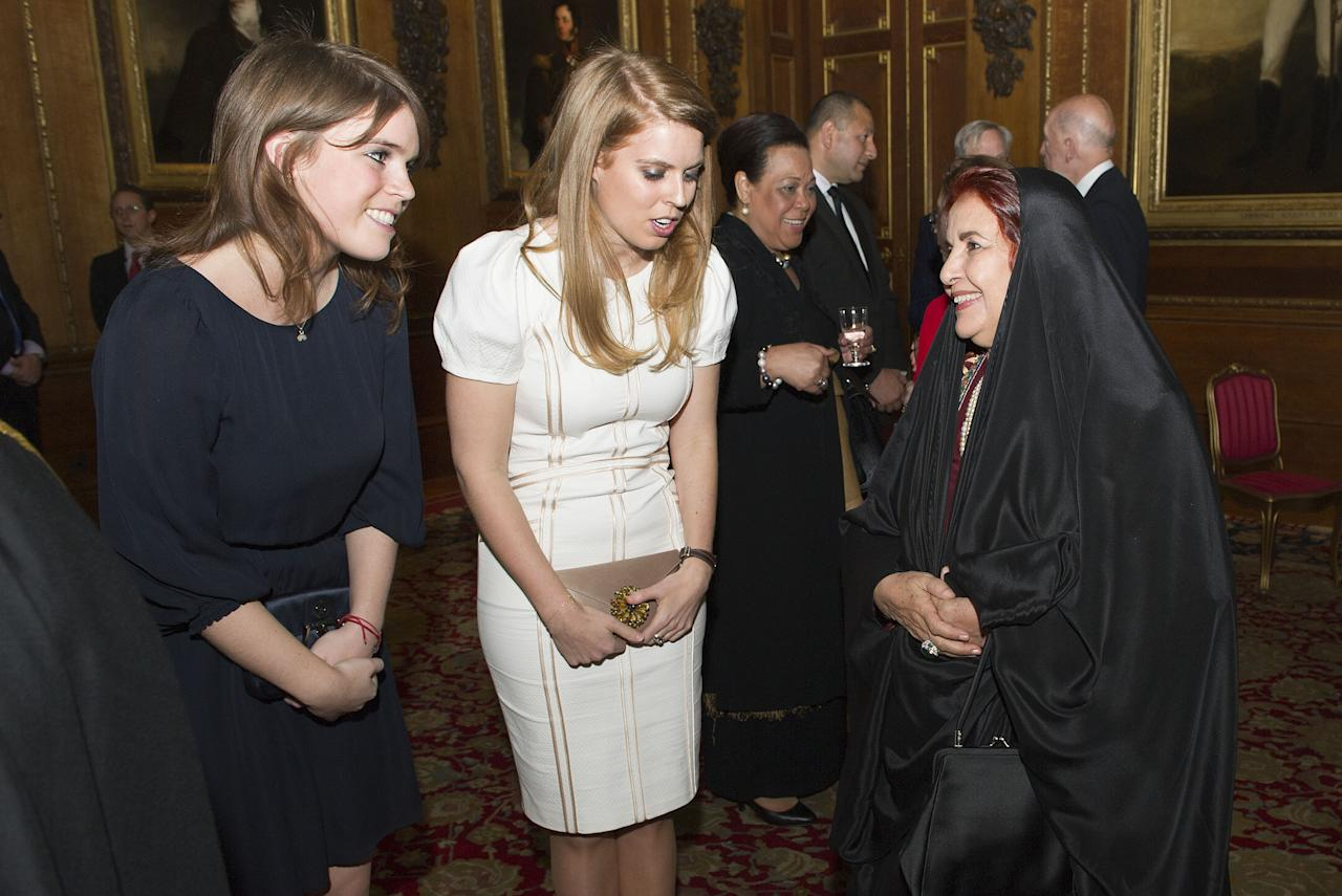 WINDSOR, ENGLAND - MAY 18: Princess Eugenie and Princess Beatrice speak with Princess Sabeeka of Bahrain during a reception in the Waterloo Chamber, before the Lunch For Sovereign Monarchs at Windsor Castle, on May 18, 2012 in Windsor, England. (Photo by Arthur Edwards - WPA Pool/Getty Images)