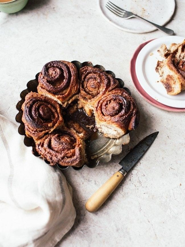 """<h3>Simple Cinnamon Rolls</h3> <br>Is there anything better than a vegan take on a cinnamon roll? Requiring the simplest of ingredients, you'll be able to recreate this easily during quarantine. <br><br><em>Recipe by </em><a href=""""https://topwithcinnamon.com/simple-cinnamon-rolls-vegan-option/"""" rel=""""nofollow noopener"""" target=""""_blank"""" data-ylk=""""slk:Izy Hossack"""" class=""""link rapid-noclick-resp""""><em>Izy Hossack</em></a><br><br><br>"""