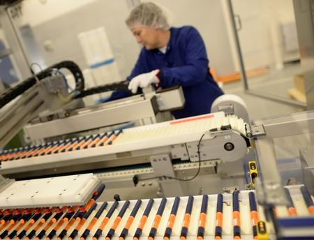 FILE PHOTO: A Novo Nordisk employee controls a machine at an insulin production line in a plant in Kalundborg