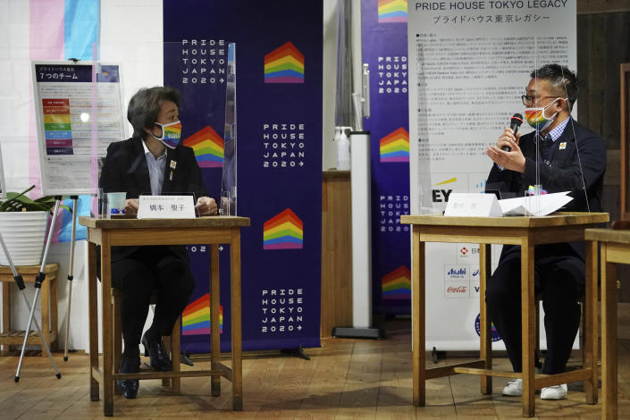 Tokyo 2020 Organizing Committee President Seiko Hashimoto, left, listens to Gon Matsunaka, head of Pride House Tokyo Legacy, during her visit, in Tokyo Tuesday, April 27, 2021. Japan marked LGBTQ week with pledge to push for equality law before the Olympics. (AP Photo/Eugene Hoshiko, Pool)