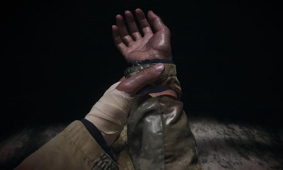"""<span class=""""caption"""">The extensive damage done to lead character Ethan's hands in 'Resident Evil' sparked online commentary. </span> <span class=""""attribution""""><span class=""""source"""">(Screenshot of Resident Evil: Biohazard/Capcom)</span></span>"""