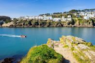 """<p>Walkers and beach lovers will love this spot on the south Cornwall coast, with its fabulous views across the sparkling sea in summer, as well as quiet beaches and the famous South West Coast Path to explore. </p><p>Fowey itself is a typical Cornish harbour town, so expect a lively atmosphere and several cafés and pubs serving up tasty fish and chips or a traditional cream tea.</p><p><strong>Where to stay:</strong> The luxurious <a href=""""https://go.redirectingat.com?id=127X1599956&url=https%3A%2F%2Fwww.booking.com%2Fhotel%2Fgb%2Ffowey-hall-a-luxury-family.en-gb.html%3Faid%3D2070935%26label%3Dnational-trust-cornwall&sref=https%3A%2F%2Fwww.countryliving.com%2Fuk%2Ftravel-ideas%2Fstaycation-uk%2Fg35461727%2Fnational-trust-cornwall%2F"""" rel=""""nofollow noopener"""" target=""""_blank"""" data-ylk=""""slk:Fowey Hall"""" class=""""link rapid-noclick-resp"""">Fowey Hall</a>, a country house hotel with top-notch facilities, is home to a swimming pool, sun terrace, gardens and hot tub overlooking the sea – plus a sophisticated double AA Rosette-awarded restaurant. </p><p><a href=""""https://www.countrylivingholidays.com/offers/cornwall-fowey-hall-hotel"""" rel=""""nofollow noopener"""" target=""""_blank"""" data-ylk=""""slk:Read our hotel review of Fowey Hall"""" class=""""link rapid-noclick-resp"""">Read our hotel review of Fowey Hall</a></p><p><a class=""""link rapid-noclick-resp"""" href=""""https://go.redirectingat.com?id=127X1599956&url=https%3A%2F%2Fwww.booking.com%2Fhotel%2Fgb%2Ffowey-hall-a-luxury-family.en-gb.html%3Faid%3D2070935%26label%3Dnational-trust-cornwall&sref=https%3A%2F%2Fwww.countryliving.com%2Fuk%2Ftravel-ideas%2Fstaycation-uk%2Fg35461727%2Fnational-trust-cornwall%2F"""" rel=""""nofollow noopener"""" target=""""_blank"""" data-ylk=""""slk:CHECK PRICES"""">CHECK PRICES</a></p>"""