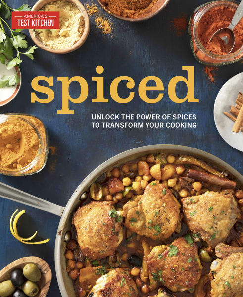 """This image provided by America's Test Kitchen in May 2019 shows the cover for the cookbook """"Spiced."""" It includes a recipe for Crispy Salt and Pepper Shrimp. (America's Test Kitchen via AP)"""