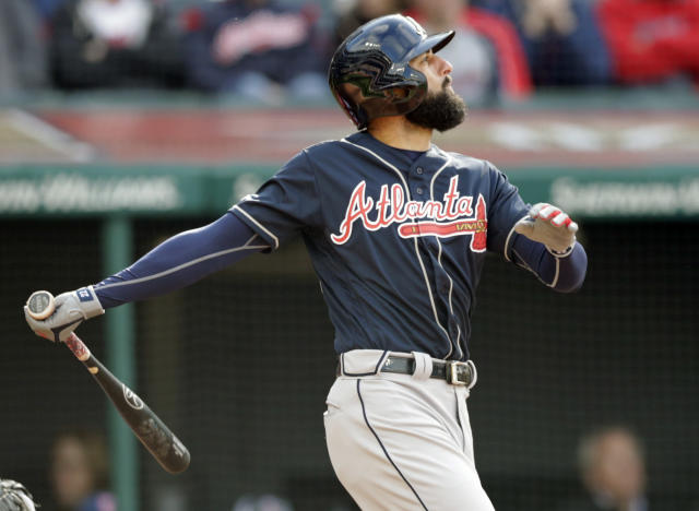 Atlanta Braves' Nick Markakis watches his ball after hitting a sacrifice fly off Cleveland Indians starting pitcher Corey Kluber in the third inning during the first game of a baseball doubleheader, Saturday, April 20, 2019, in Cleveland. Ozzie Albies scored on the play. (AP Photo/Tony Dejak)
