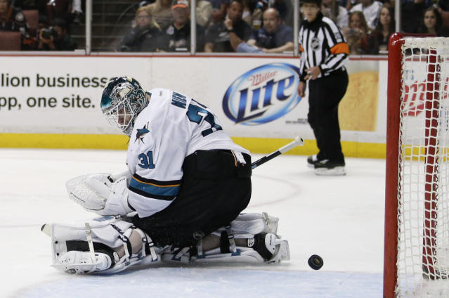 A shot by Anaheim Ducks' Patrick Maroon enters the net past San Jose Sharks goalie Antti Niemi, of Finland, during the second period of an NHL hockey game on Wednesday, April 9, 2014, in Anaheim, Calif. (AP Photo/Jae C. Hong)