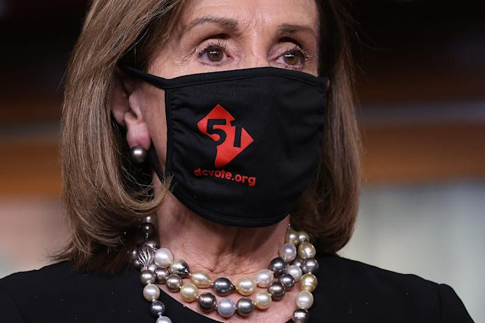 """WASHINGTON, DC - APRIL 21: Speaker of the House Nancy Pelosi (D-CA) wears a '51' face mask during a news conference about statehood for the District of Columbia at the U.S. Capitol on April 21, 2021 in Washington, DC.  The House of Representatives will vote Thursday on H.R.51, the """"Washington, DC Admission Act,"""" which would grant statehood to the residents of the District of Columbia. (Photo by Chip Somodevilla/Getty Images) ORG XMIT: 775646980 ORIG FILE ID: 1313691561"""
