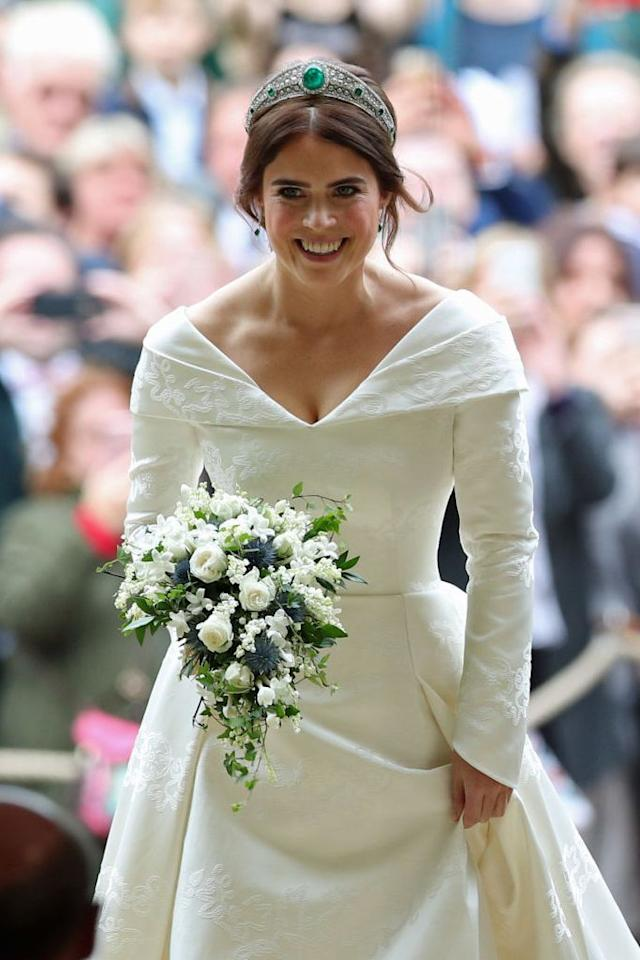 "<p><strong>Wedding date: </strong>October 12, 2018</p><p><strong>Wedding tiara: </strong><a href=""https://www.townandcountrymag.com/society/tradition/a15841755/princess-eugenie-jack-brooksbank-wedding/"" target=""_blank"">Eugenie wore the</a> Greville Emerald Kokoshnik tiara on her wedding day, which was lent to her by her grandmother, Queen Elizabeth. <a href=""https://www.townandcountrymag.com/style/jewelry-and-watches/a22168053/princess-eugenie-wedding-tiara/?utm_campaign=likeshopme&utm_medium=instagram&utm_source=www.instagram.com/p/Bo1J1aVBSLP/&utm_content=www.instagram.com/p/Bo1J1aVBSLP/"" target=""_blank"">The tiara was created in 1919</a> by Boucheron for Margaret Greville, a British society fixture and philanthropist<strong>. </strong>When Greville died in 1942, she bequeathed the tiara to the Queen's mother<strong>. </strong>The gorgeous central emerald on the tiara is a whopping 93.7 carats in size. <strong></strong><strong><br></strong></p>"