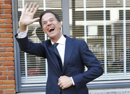 Dutch Prime Minister Mark Rutte of the VVD party waves after voting in the general election in The Hague