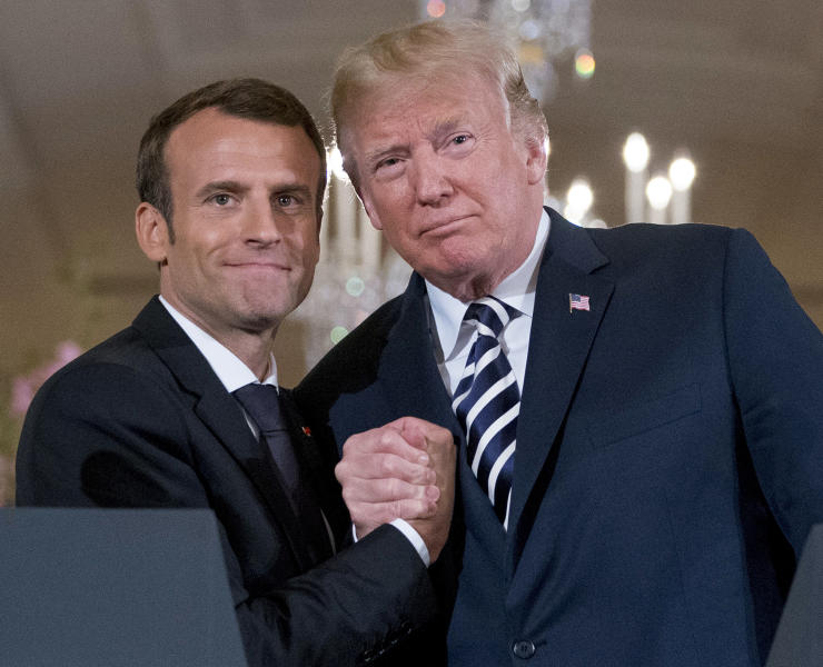 """FILE - In this Tuesday, April 24, 2018 file photo President Donald Trump and French President Emmanuel Macron embrace at the conclusion of a news conference in the East Room of the White House in Washington. President Donald Trump promised on Friday July 26, 2019 to retaliate against France for adopting a pioneering tax on internet giants like Google, Amazon and Facebook. Trump said referring to French President Emmanuel Macron: """"We will announce a substantial reciprocal action on Macron's foolishness shortly."""" (AP Photo/Andrew Harnik, File)"""