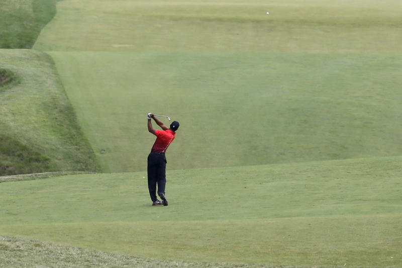 Tiger Woods hits down the 18th hole during the fourth round of the U.S. Open golf tournament at Merion Golf Club, Sunday, June 16, 2013, in Ardmore, Pa. (AP Photo/Gene J. Puskar)