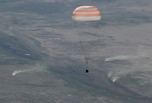 A Soyuz space capsule carrying Russian cosmonaut Anton Shkaplerov, US astronaut Scott Tingle and Japanese astronaut Norishige Kanai lands safely in Kazakhstan