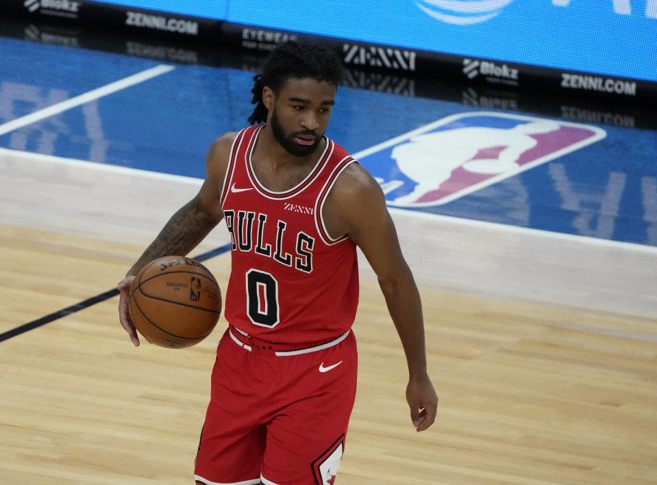 Mar 24, 2021; Chicago, Illinois, USA; Chicago Bulls guard Coby White (0) dribbles the ball against the Cleveland Cavaliers during the second quarter at the United Center.