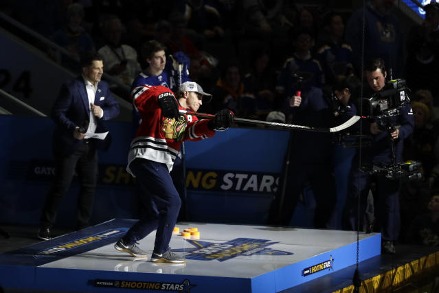 Chicago Blackhawks' Patrick Kane shoots during the Skills Competition shooting stars event, part of the NHL All-Star weekend, Friday, Jan. 24, 2020, in St. Louis. Kane won the event. (AP Photo/Jeff Roberson)
