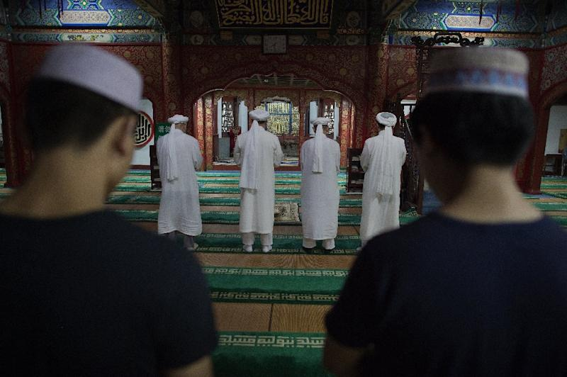 "One of China's most popular online communities for Muslims has been shuttered after posting a petition asking Chinese President Xi Jinping to stop his ""brutal suppression"" of activists (AFP Photo/Nicolas Asfouri)"